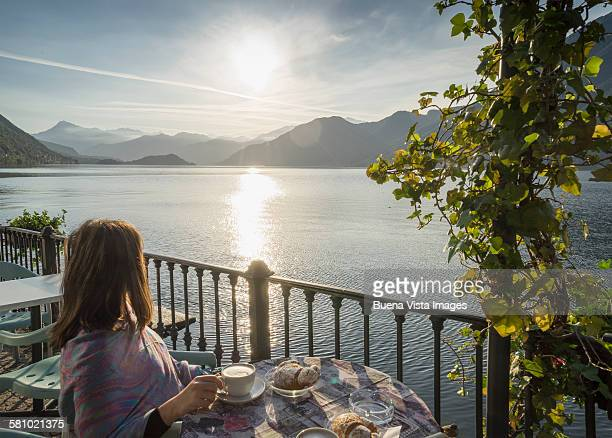 Woman having Cappuccino on Lake Como