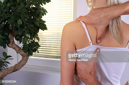 Woman having chiropractic back adjustment close up. : Stock Photo