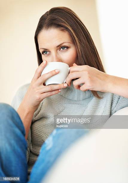 Woman having coffee in couch