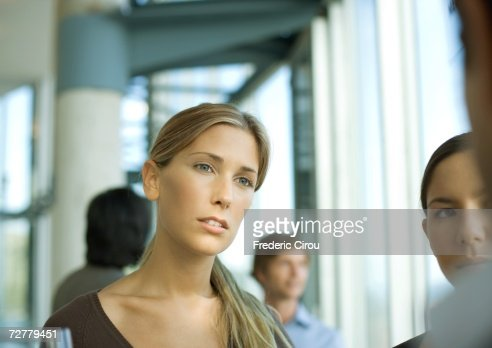 Woman having conversation during cocktail party
