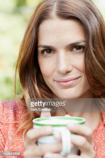 Woman having cup of coffee outdoors : Stock Photo