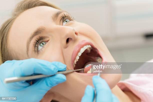 Woman having dental inspection