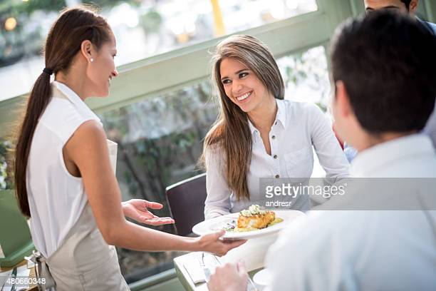 Woman having dinner at a restaurant