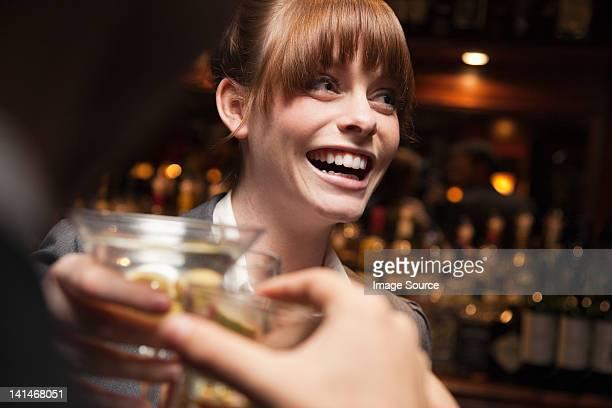 Woman having drinks at bar