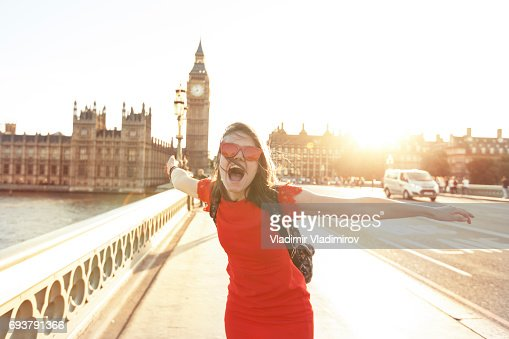 Woman having fun at sunset : Stock Photo