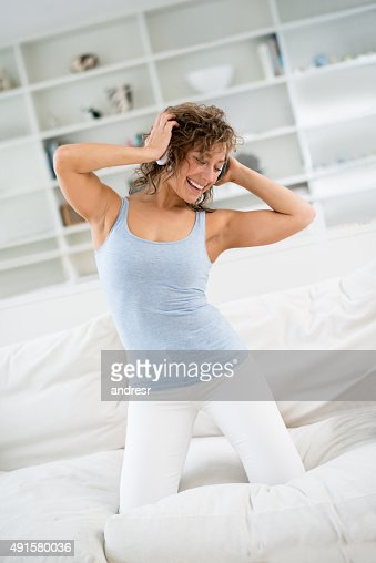 Woman having fun listening to music at home
