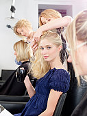 Woman having hair cut in salon