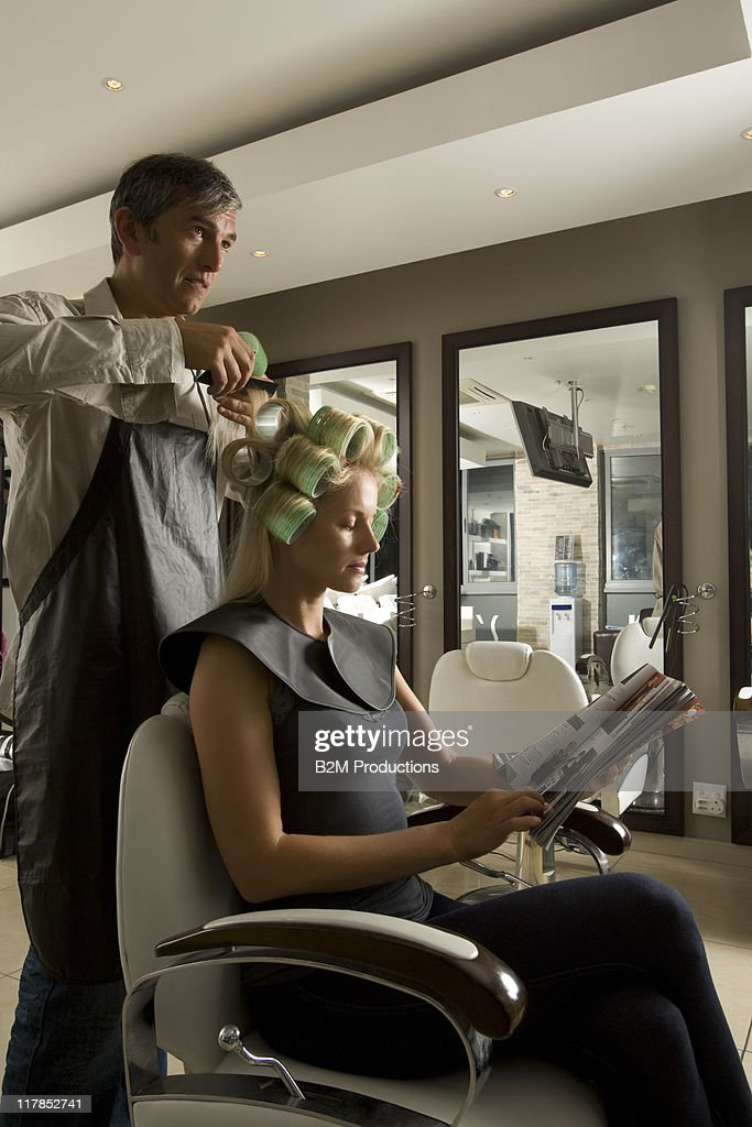 Woman having hair done : Stock Photo