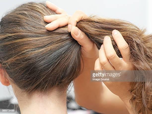 Woman having hair done