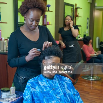 woman having hair styled at hair salon : Stock Photo