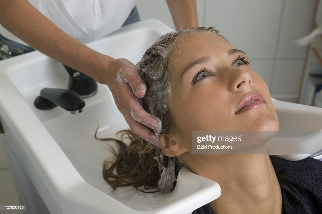 Woman having Hair Washed by a Hairdresser : Stock Photo