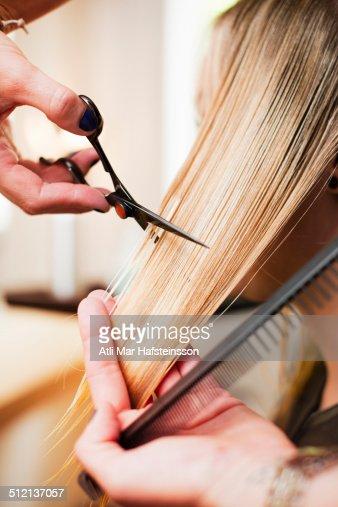 Woman having haircut in salon
