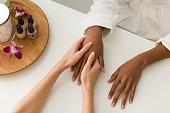 Woman having hands massaged