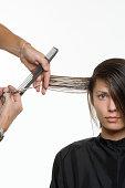 A woman having her hair cut