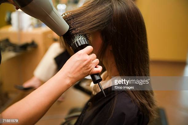 A woman having her hair styled at a salon