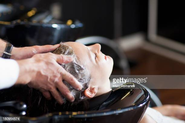 Woman having her hair washed in salon