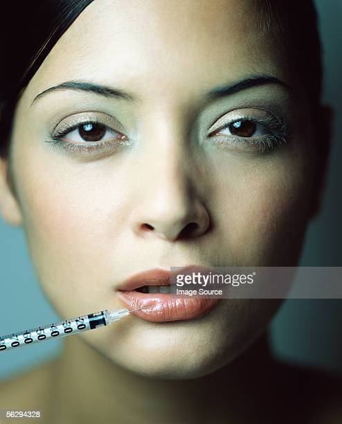 Woman having injection in her lip