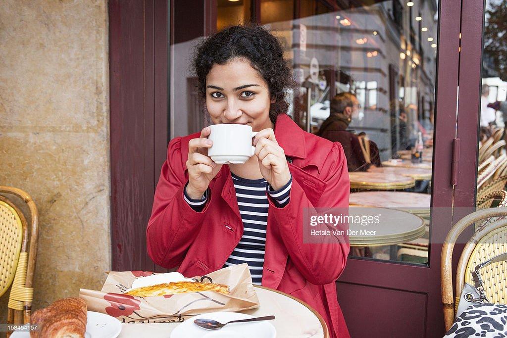 Woman having lunch break in parisian cafe. : Stock Photo