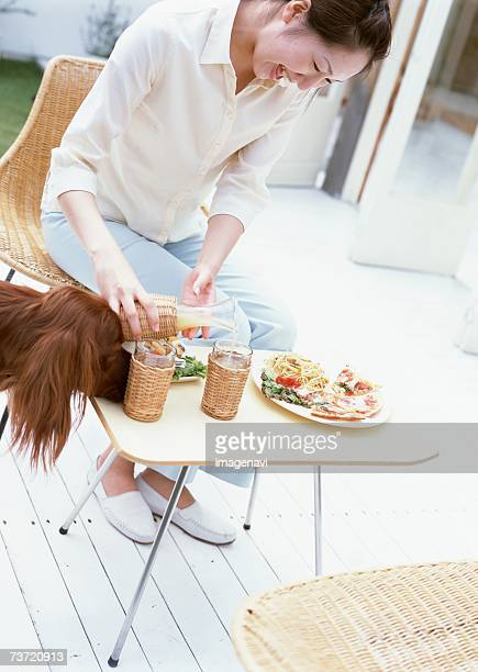 Woman having lunch with dog