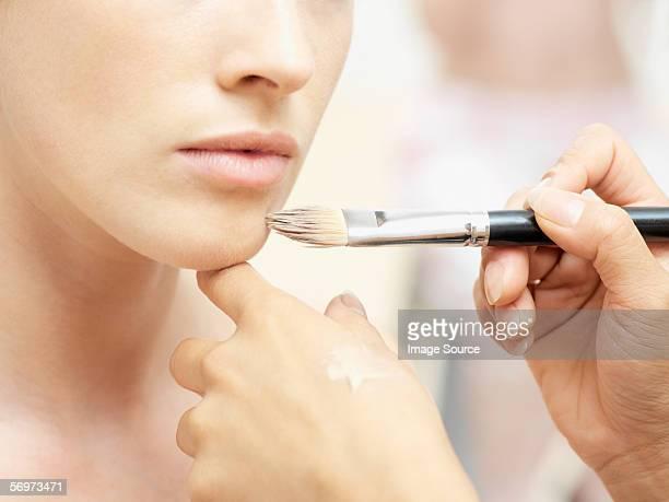 Woman having make-up done
