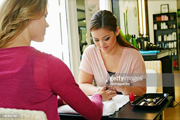 Woman having nails done in salon
