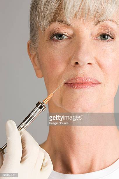 Woman having neurotoxin injection