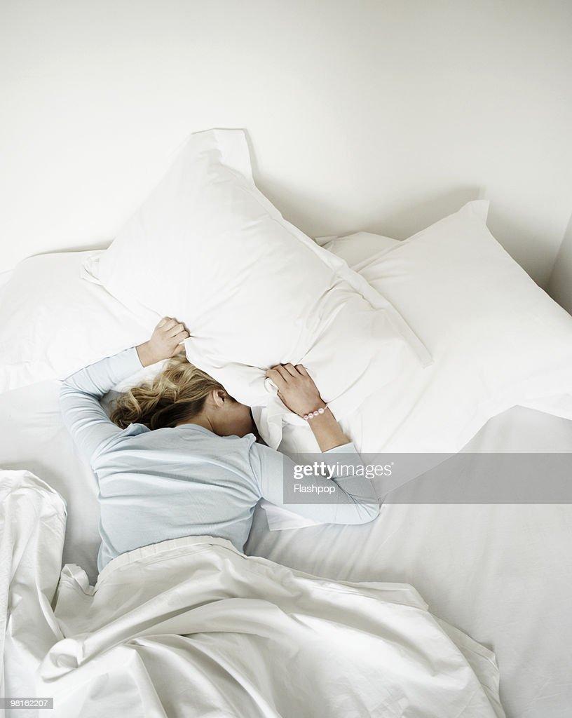 Woman having restless nights sleep : Stock Photo
