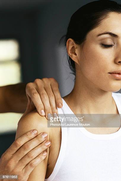 Woman having shoulder massaged