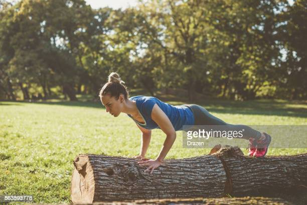 Woman having strength training outdoors