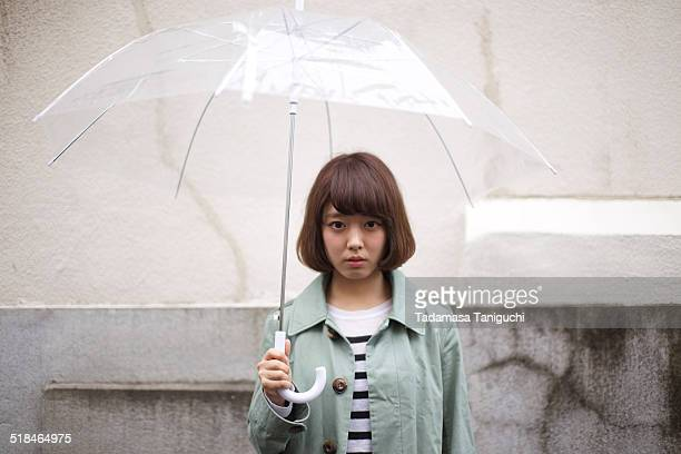 Woman having umbrella