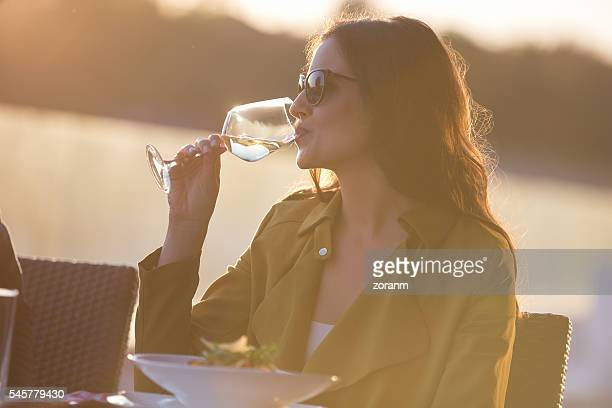 Woman having white wine