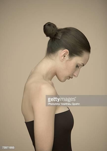Woman, head down, portrait