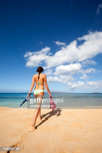 A woman heading out snorkeling.