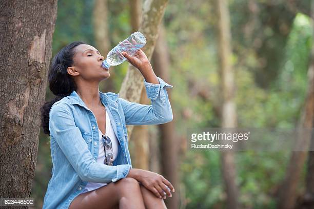 Woman healthy drinking outdoors.
