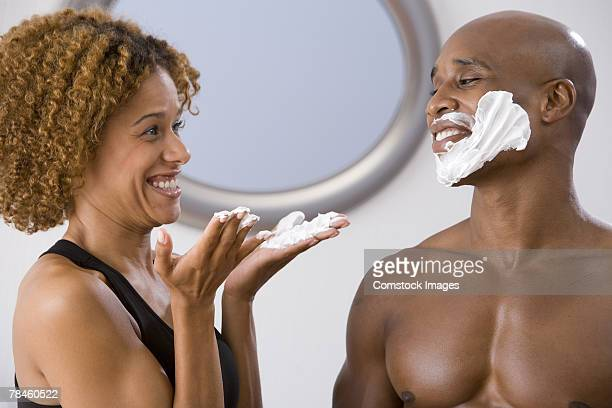 Woman helping man shave