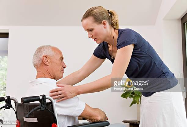 woman helping senior man