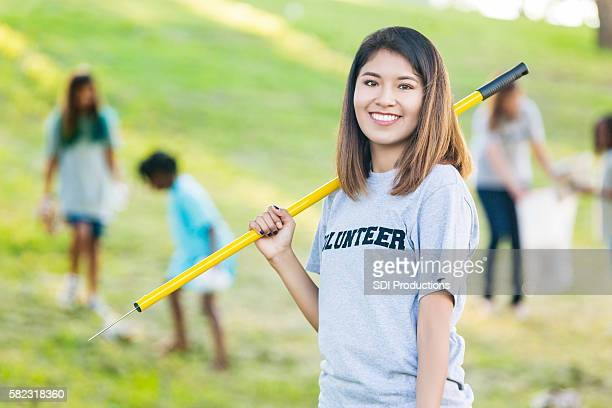 Woman helps neighbors clean up community park