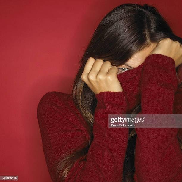 Woman hiding in her turtleneck sweater