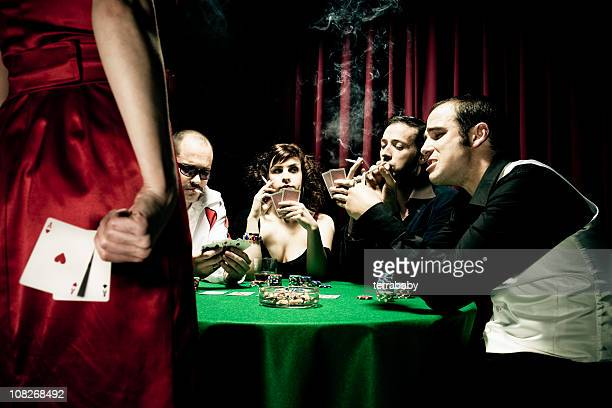 Woman Hiding Two Aces Behind Back During Poker Game