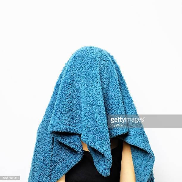 Woman Hiding Under Blanket