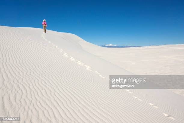 Woman hiker explores White Sands National Monument New Mexico mountains