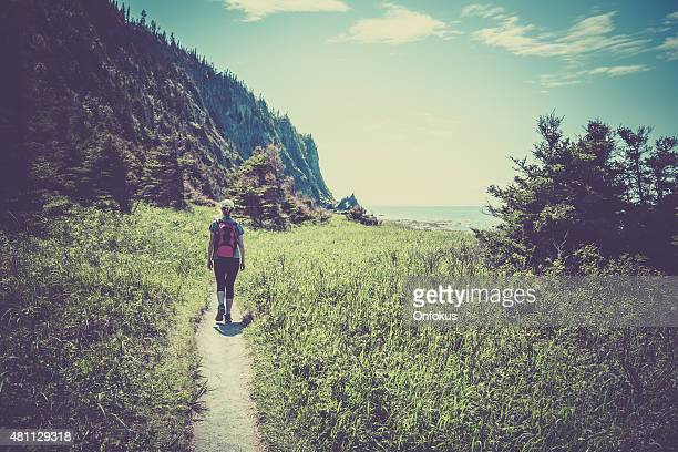 Woman Hiker Walking on a Trail