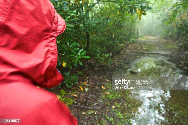 A woman hikes on a rainy day in North Carolina.