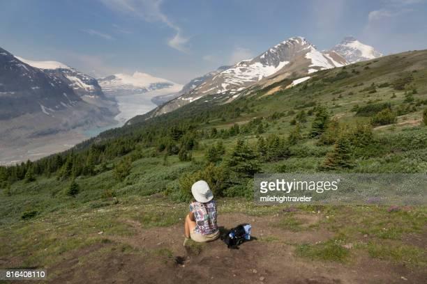Woman hikes Parker Ridge Saskatchewan Glacier Banff National Park Alberta Canada