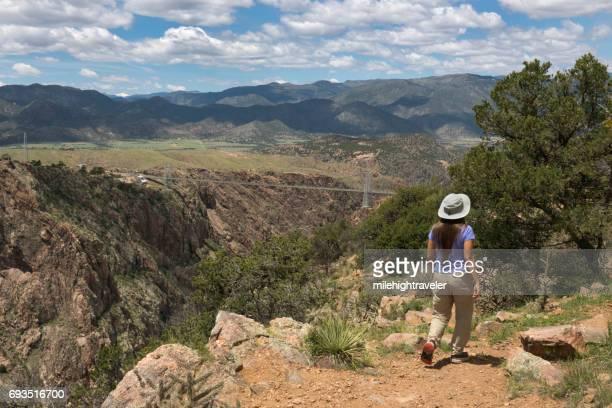 Woman hikes Royal Gorge Canyon City Colorado Arkansas River