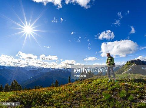 Woman hiking high on ridge