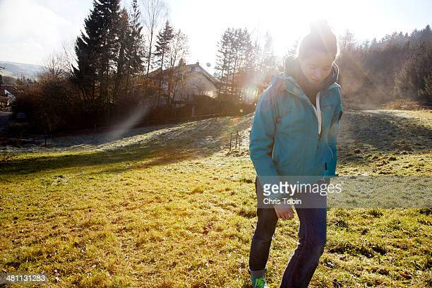 Woman hiking in countryside