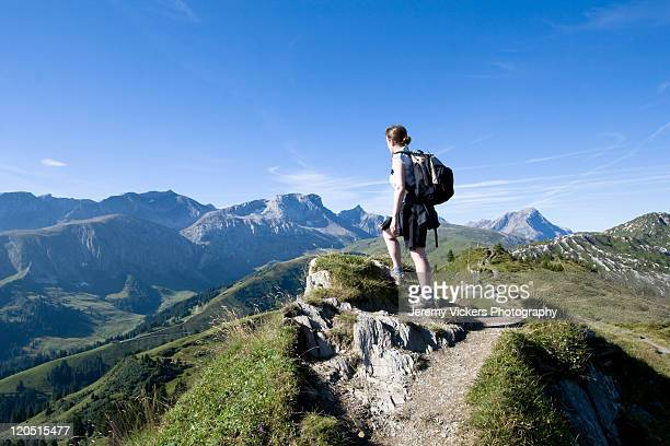 Woman hiking In spectacular swiss mountains