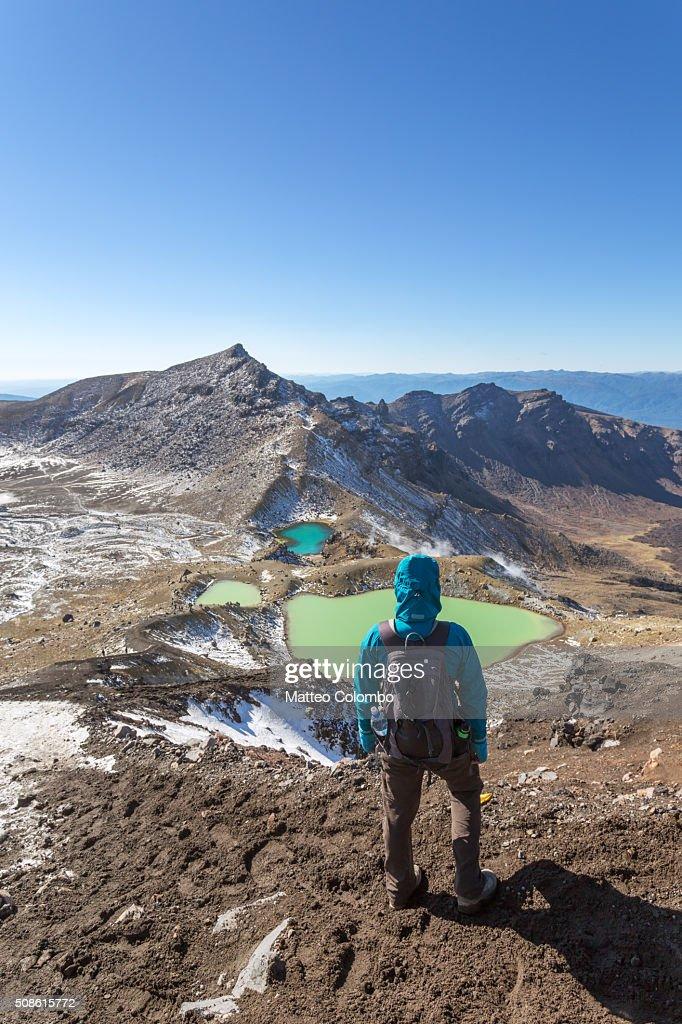 Woman hiking near emerald lakes, Tongariro, New Zealand : Stock Photo
