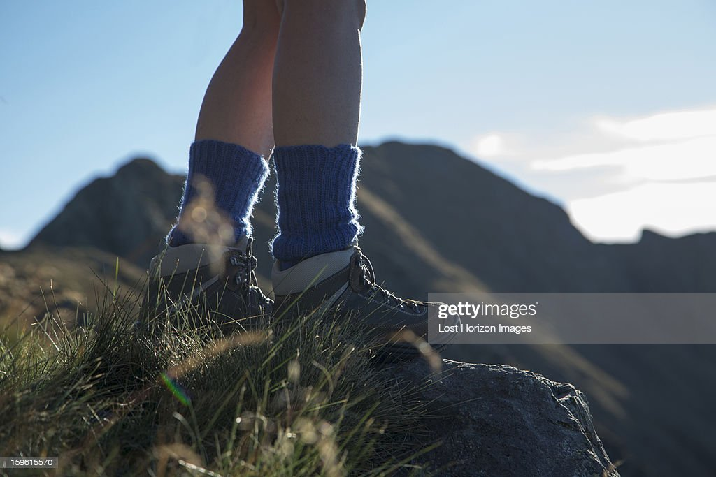 Woman hiking on rural hillside : Stock Photo